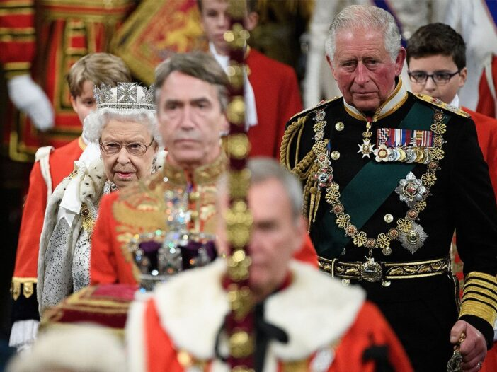 Prince Charles and Queen Elizabeth in procession at the official opening of parliament.