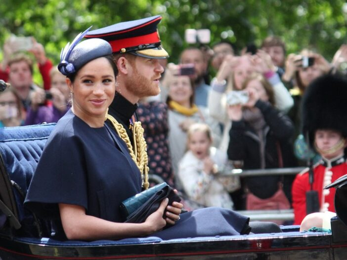 Prince Harry and Meghan Markle in a horse-drawn carriage.