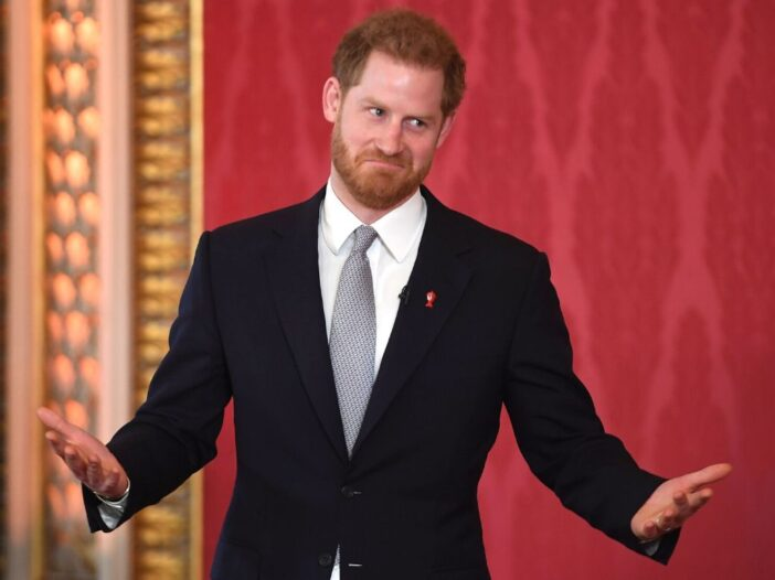 Prince Harry wearing a black suit while hosting the Rugby League World Cup 2021 Draws