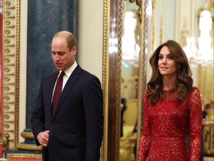 Prince William and Kate Middleton walking in Buckingham Palace