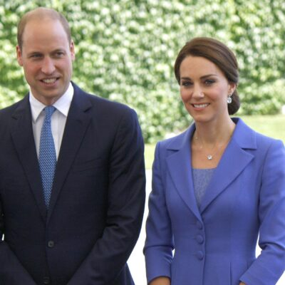 Prince William in a navy suit and Kate Middleton in a blue jacket and top while in Berlin.