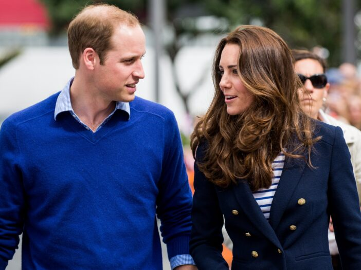Prince William wears a blue sweater while out at a royal event with Kate Middleton, in a blue blazer