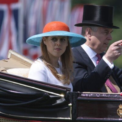 Princess Beatrice with her father Prince Andrew in a horse-drawn carriage.