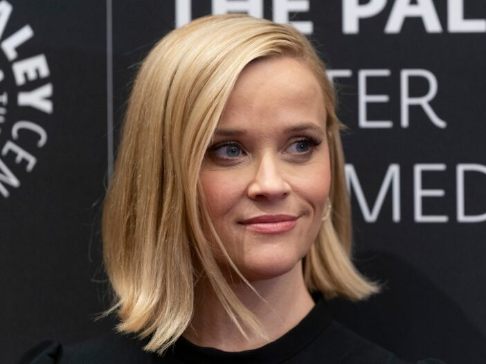 Reese Witherspoon wearing a black dress at a screening for The Morning Show