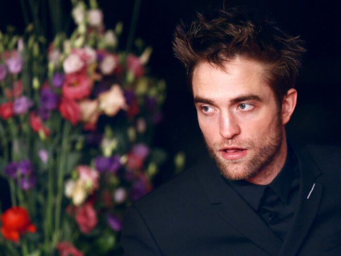Robert Pattinson wears an all black suit at the 68th Film Festival Berlin