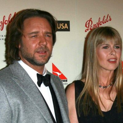 Russel Crowe on the left in a tuxedo, Terri Irwin on the right in a black dress.