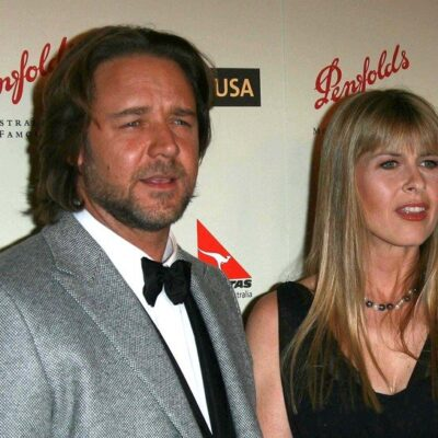 Russell Crowe in the left attending a red carpet event with Terri Irwin, on the right