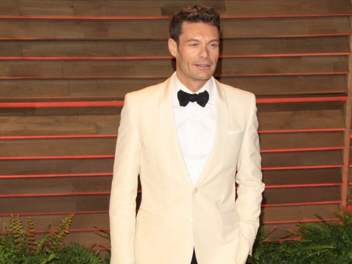 Ryan Seacrest wears a white tux jacket with black bow tie to a Vanity Fair Oscars party.