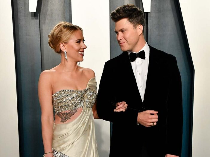 Scarlett Johansson and Colin Jost with their arms locked