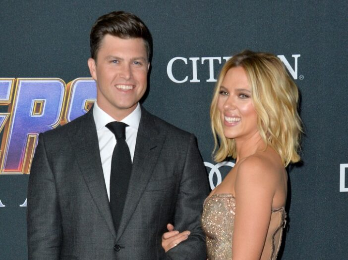 Scarlett Johansson smiles arm in arm with Colin Jost at a red carpet event