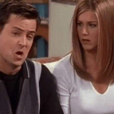 Screenshot from Friends, Matthew Perry on the left making a funny face, Jennifer Aniston on the right looking upset.