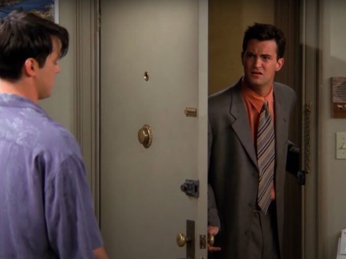Screenshot from Friends of Matthew Perry as Chandler Bing in a suit