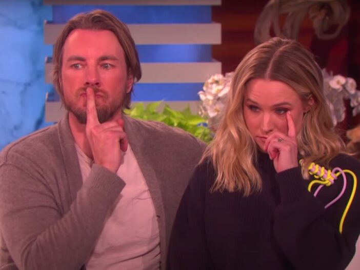 Screenshot from the Ellen DeGeneres show of Kristen Bell in a black sweater, Dax Shepard in a grey cardigan sitting on a couch