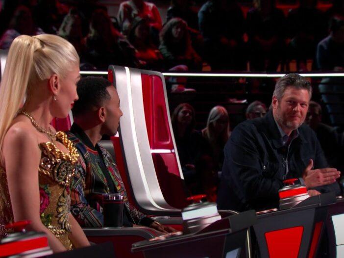 Screenshot of Gwen Stefani jokingly glaring at Blake Shelton talking on The Voice