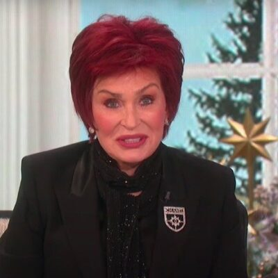 screenshot of Sharon Osbourne on The Talk in a black blouse