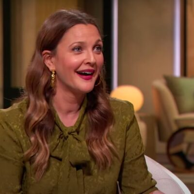 Screenshot of the Drew Barrymore Show with Drew Barrymore talking in a green outfit