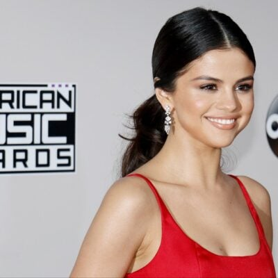 Selena Gomez wearing a red dress to the American Music Awards