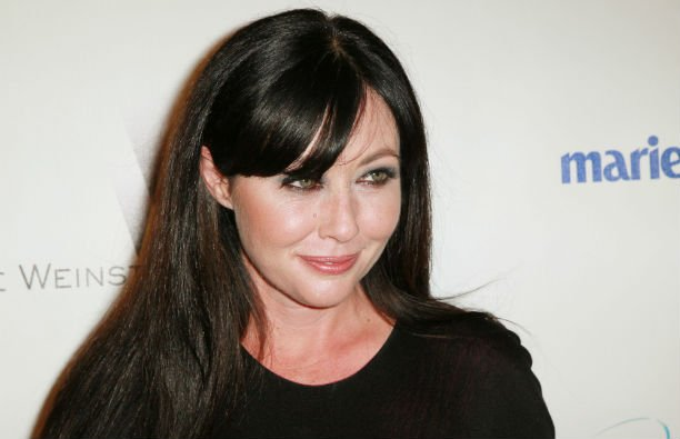 Shannen Doherty wearing a black top on the red carpet.