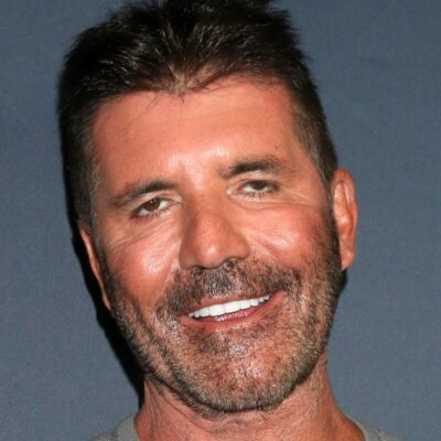 Simon Cowell, wearing a gray sweater, arrives for the premiere of America's Got Talent Season 14