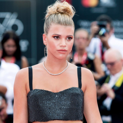 Sofia Richie wearing a black, sparkly crop top on the red carpet