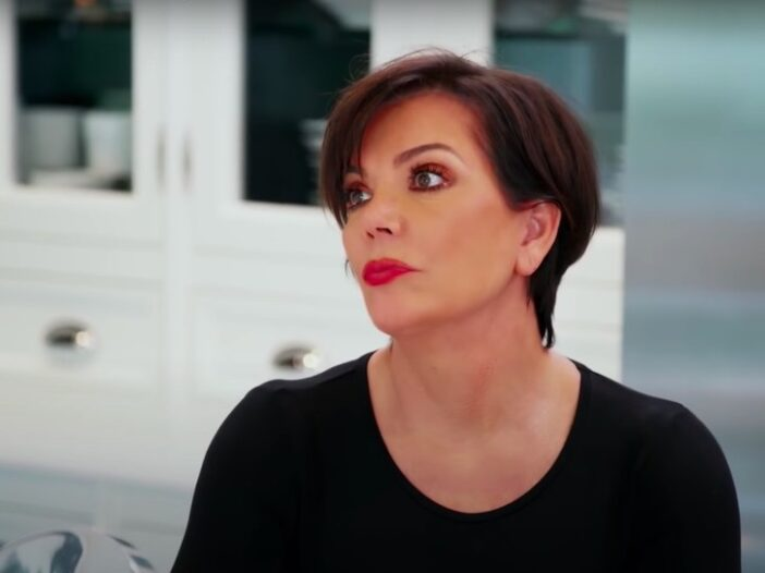 still from Keeping Up with the Kardashians of Kris Jenner in a black shirt