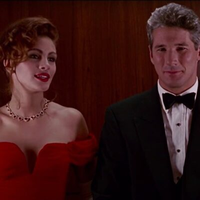 still from Pretty Woman with Julia Roberts in a red dress and Richard Gere in a tuxedo