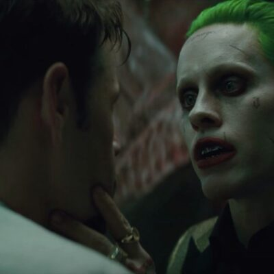 still from Suicide Squad featuring Jared Leto as Joker grabbing a man's face
