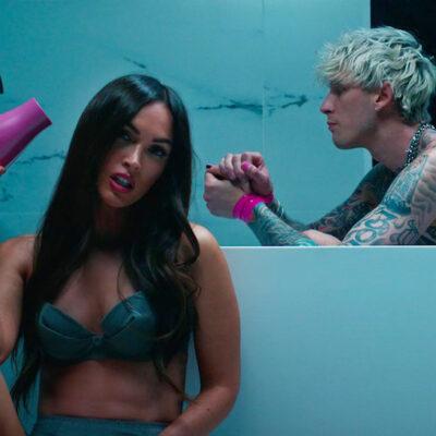 Still from the Bloody Valentine music video of Megan Fox in a bikini and Machine Gun Kelly in a tub