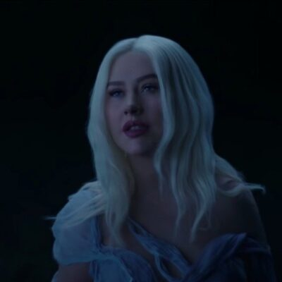 still from the Reflections music video of Christina Aguilera in a white dress