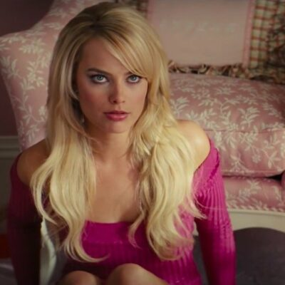 still of Margot Robbie in a pink sweater from Wolf of Wall Street