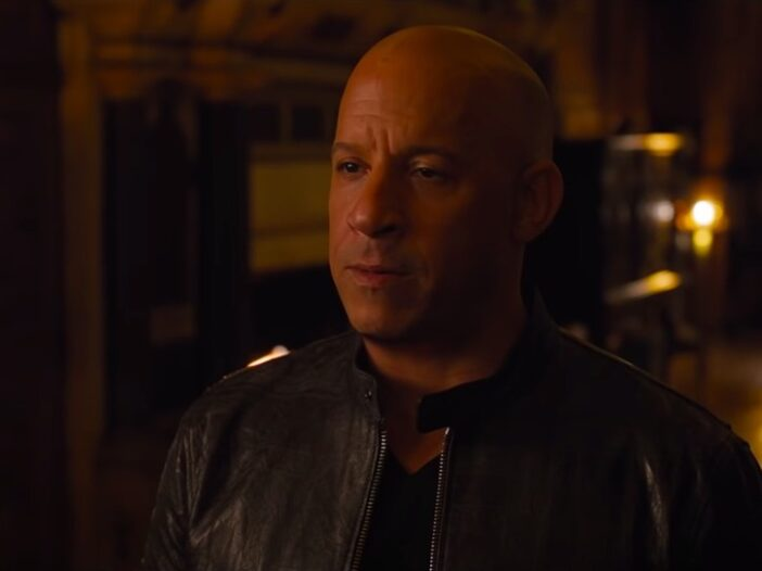 still of Vin Diesel wearing a leather jacket and staring ahead from Fast & Furious 9 The Fast Saga