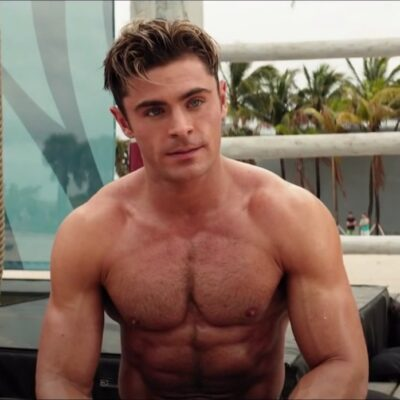 still of Zac Efron shirtless from the movie Baywatch
