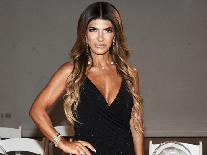 Teresa Giudice wearing a black sparkly dress during New York Summer Fashion Explosion