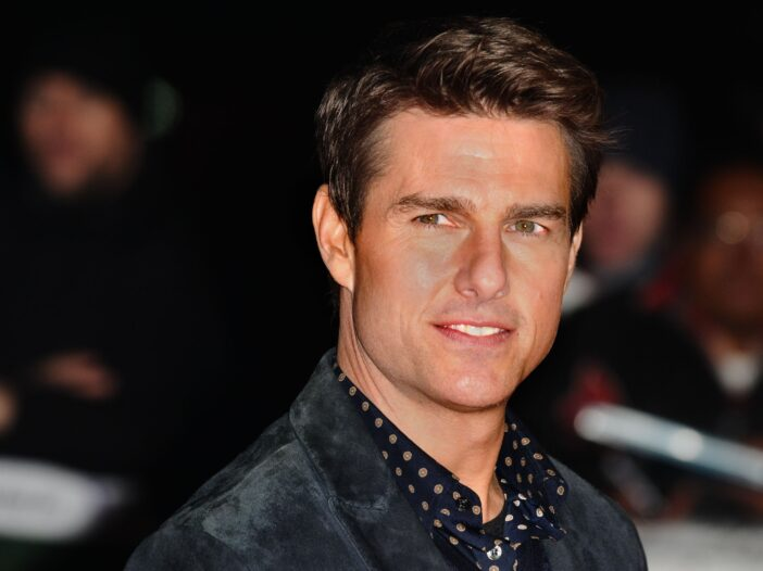 Tom Cruise looking to the right, over his shoulder.
