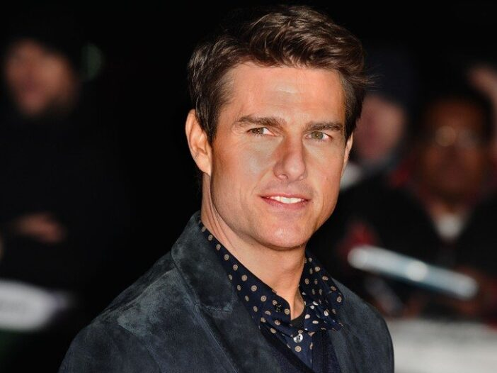 Tom Cruise turning his head to the camera.