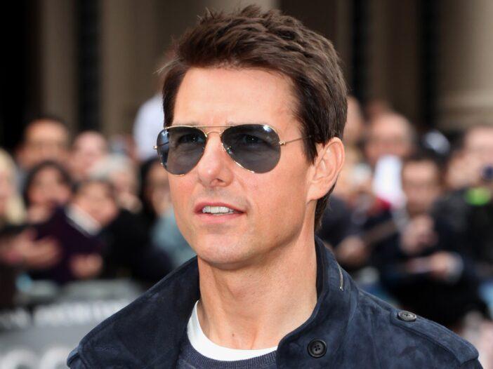 Tom Cruise where a blue jacket and sunglasses.
