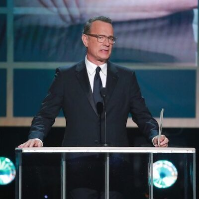 Tom Hanks in a suit presenting at the Screen Actors Guild Awards