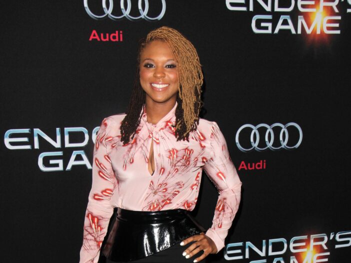 Torrei Hart at the _Ender's Game_ Los Angeles Premiere in a pink blouse and black skirt.