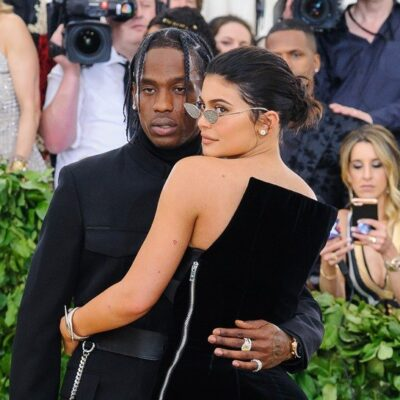 Travis Scott and Kylie Jenner, both in all black, hold each other at the Met Gala