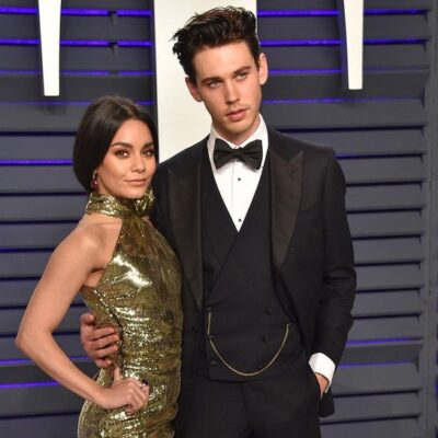 Vanessa Hudgins on the left in a long gold dress, Austin Butler on the right in a tuxedo.