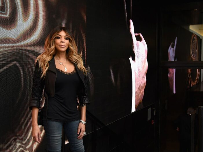 Wendy Williams in a black top and blue jeans