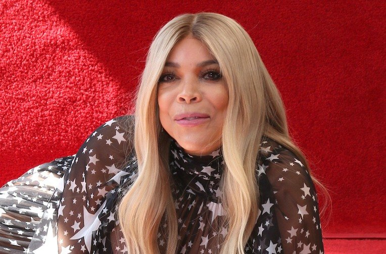 Wendy Williams on her side in a black and white dress