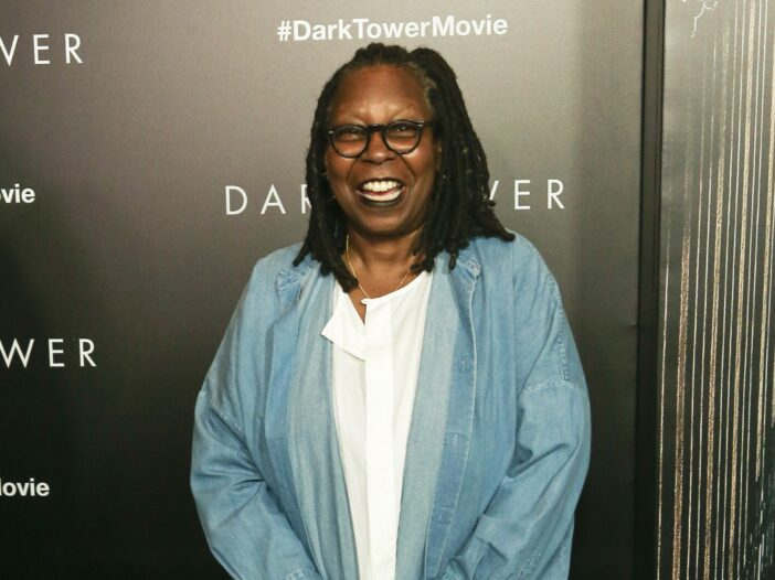 Whoopi Goldberg wearing a denim top and white shirt to the premiere of Dark Tower