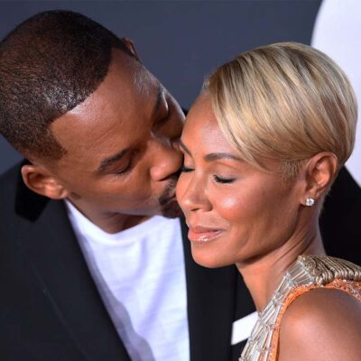 Will Smith kissing Jada Pinkett on the cheek