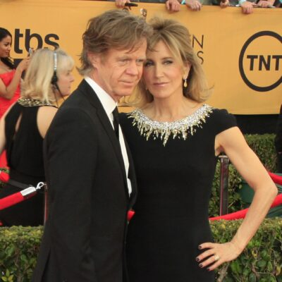 William H. Macy and Felicity Huffman together, dressed in black at a red carpet event.