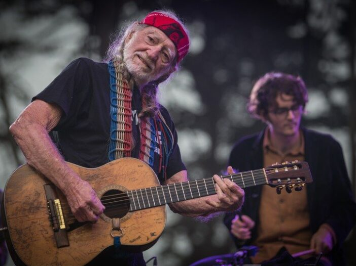 Willie Nelson performing onstage with his son Micah at the 2013 Outside Lands music festival