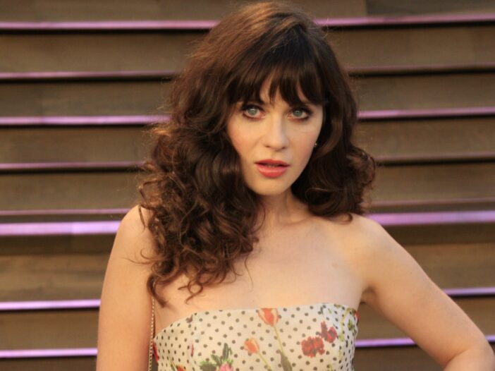 Zooey Deschanel wearing a floral and polka dot strapless dress to a Vanity Fair Oscar Party