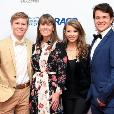 Robert Irwin, Terri Irwin, Bindi Irwin, and Chandler Powell smile together