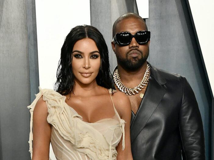 Kim Kardashian and Kanye West standing together