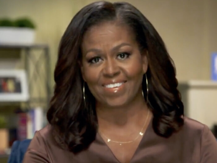 screenshot of Michelle Obama smiling at the DNCC
